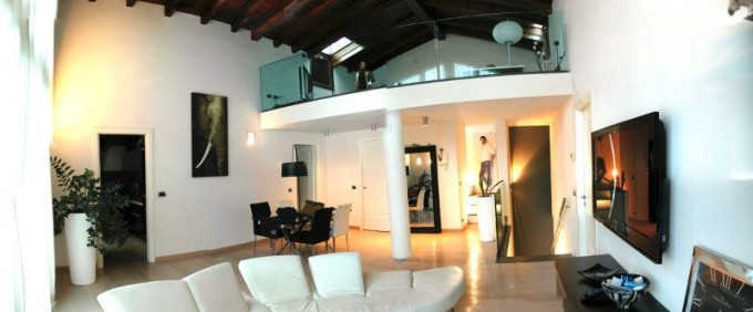 Wonderful loft in the post-industrial village, Modena Est renovated. For sale.